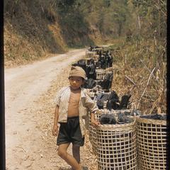 Kammu (Khmu') boy with charcoal
