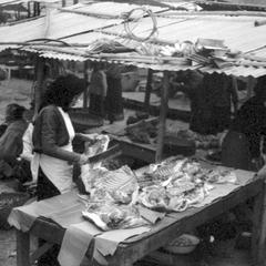 Woman butcher, probably Vietnamese, at Luang Prabang town market