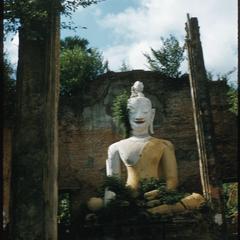 Large Buddha image, cracks on torso