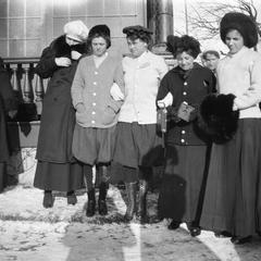 Women standing together in snow