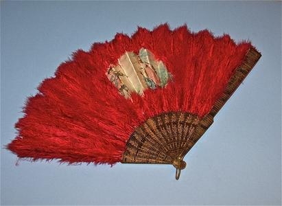Large red feather fan with painted scene