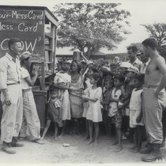 U.S. soldiers keeping order at distribution of food at GI mess, Dagupan, Pangasinan, 1945