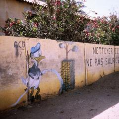 Donald Duck and Slogan on School Wall in the Fisherman's Village of Saint-Louis