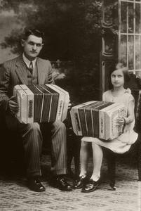 Irving DeWitz and daughter Lucile pose with concertinas