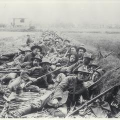 American soldiers rest during a lull in the fighting, 1899