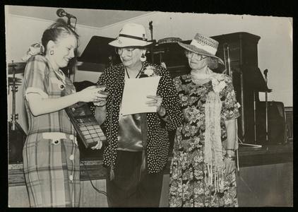 Joyce Berigan Hansen and Patricia Berigan giving out a scholarship