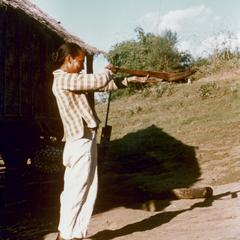 White Lahu (Lahu Hpu) man aims his crossbow in the village of Chalopha in Houa Khong Province