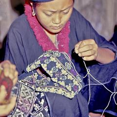 Girl embroidering