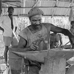 Blacksmith at Work on Anvil