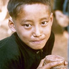 White Hmong boy with top at the village of Nam Phet in Houa Khong Province