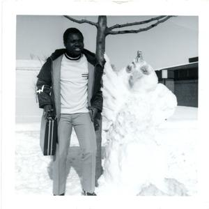 Posing with snow sculpture