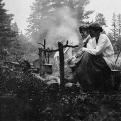 Two women at campfire at Les Cheneaux