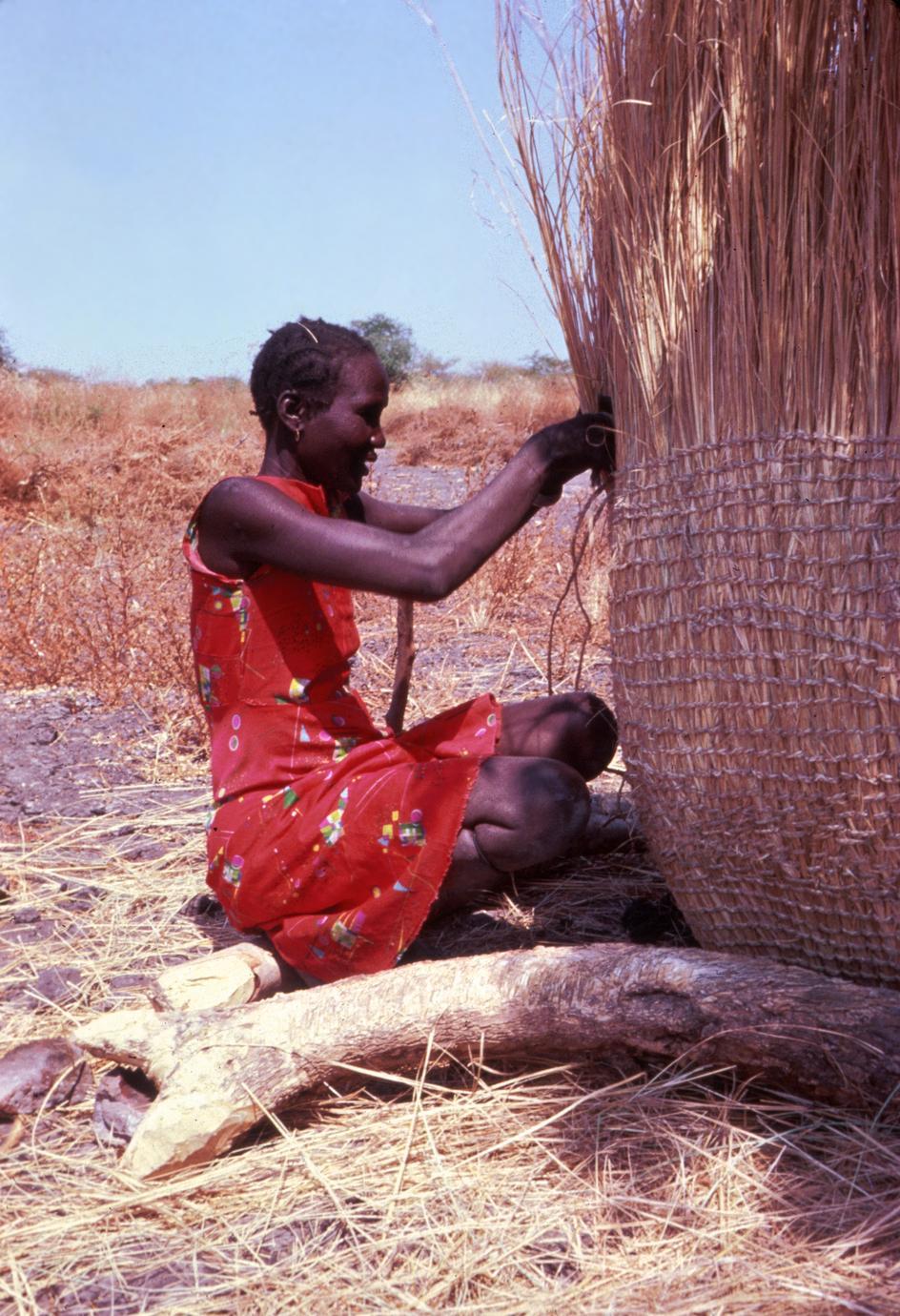 Woman Weaving a Granary
