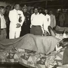 King of Laos visiting wounded soldiers