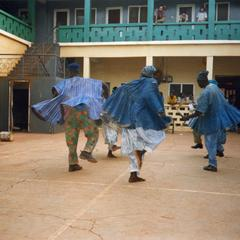 Three dancers spinning at Al Hassan Hotel