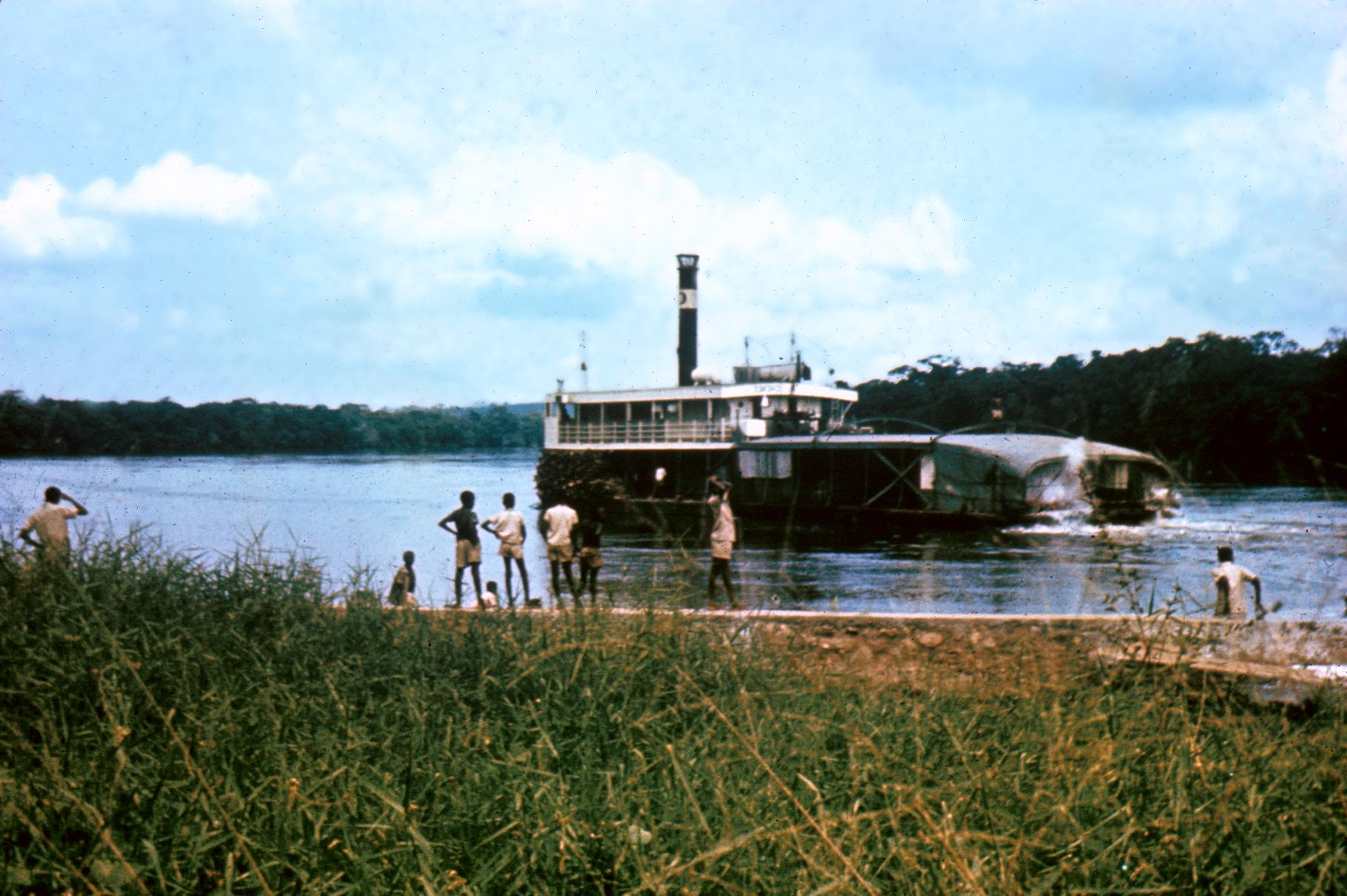 Typical Kwilu Riverboat, a Stern-Wheeler with Congolese Captain