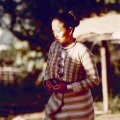 White Lahu (Lahu Hpu) woman walks in the village of Chalopha in Houa Khong Province