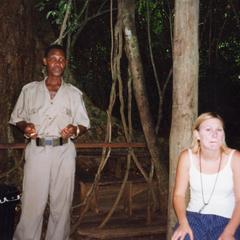 Woman and man under trees in Kakum National Park