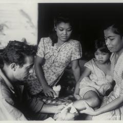 U.S. medic treats a Filipino child, 1944