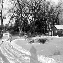 Shack and driveway in snow