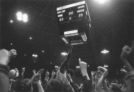 Men's basketball game scoreboard in the Brown County Veterans Memorial Arena