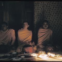 Basi : three bonzes inside house