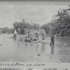 Men and women washing clothes in the river