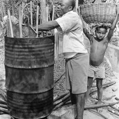 Building Up the Sides of the Cooking Barrel for Palm Nuts