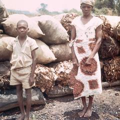 Woman and Son Selling Charcoal Along Roadside
