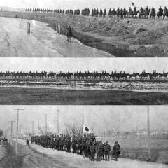Japanese troops marching on the road in a suburb of Tianjin 天津.