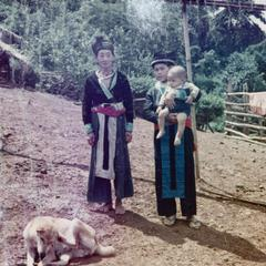 A White Hmong woman, baby and dog in Houa Khong Province