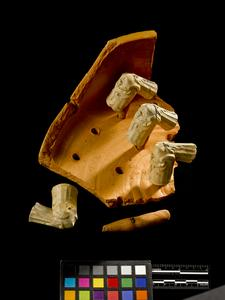 Smoking pipe sagger fragment with pins and smoking pipes