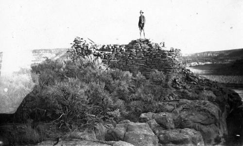 Aldo Leopold on ancient cliff house in northwestern New Mexico
