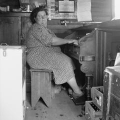 Bessie Gordon at reed organ