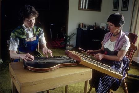Heidi Haese Schlei plays zither and Elfrieda Bergman Haese plays hackbrett