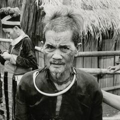 An elderly Blue Hmong (Hmong Njua) man poses on a path in a Hmong village in the vicinity of Muang Vang Vieng in Vientiane Province