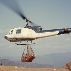 Helicopter transporting cargo
