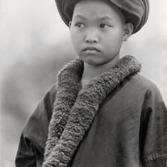 A Yao (Iu Mien) girl in traditional clothing in Houa Khong Province