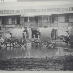 Bull carts parked in front of Castle Brothers Wolf and Sons building, Iloilo