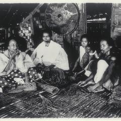 Women tying up tobacco bundles, Cagayan, 1926