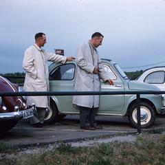 Men with tiny cars