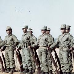 Local soldiers stand on Houei Kong landing strip in Attapu Province