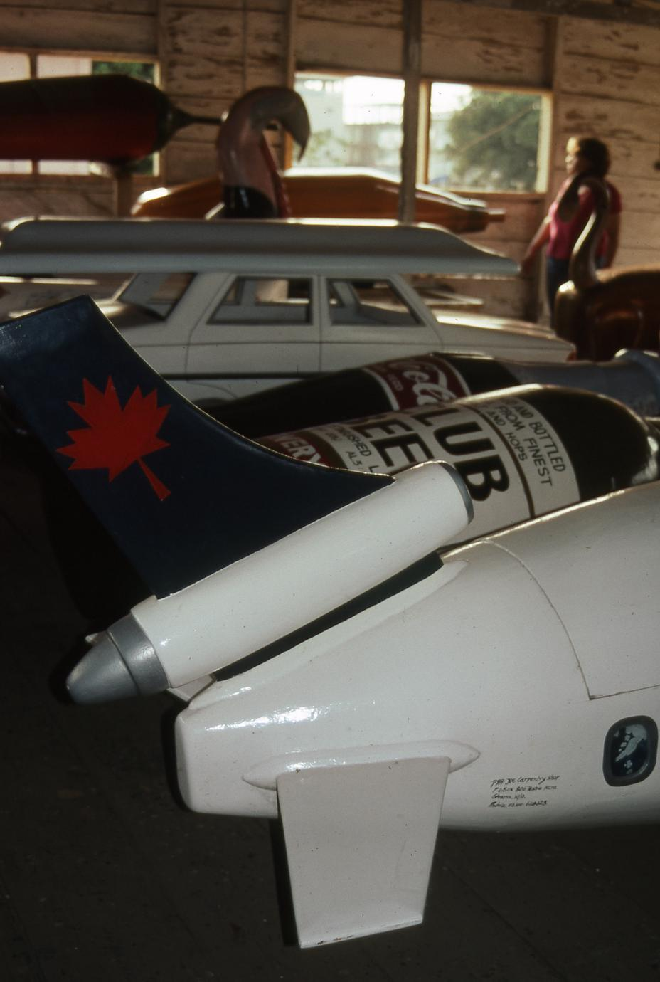 Plane and beverage replicas