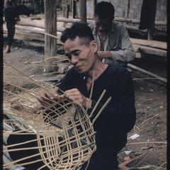 Lao men weaving baskets