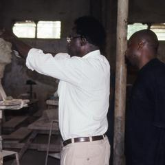 Agbo Folarin working on sculpture