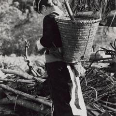 A White Hmong woman with basket in Houa Khong Province