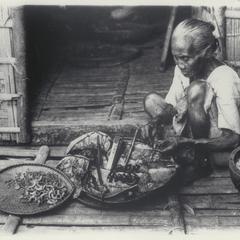 Woman pipe maker, Ilocos Norte, 1926