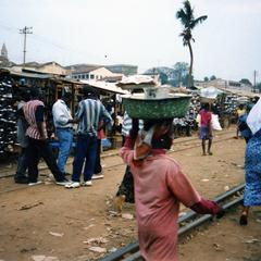 Traders near train tracks