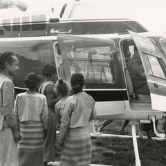 Villagers in a White Lahu village meet the USAID helicopter in Houa Khong Province