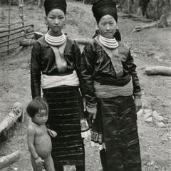 Two Blue Hmong (Hmong Njua) women and a child in the vicinity of Muang Vang Vieng in Vientiane Province